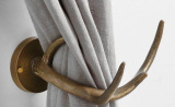 Держатель для шторы в форме оленьего рога