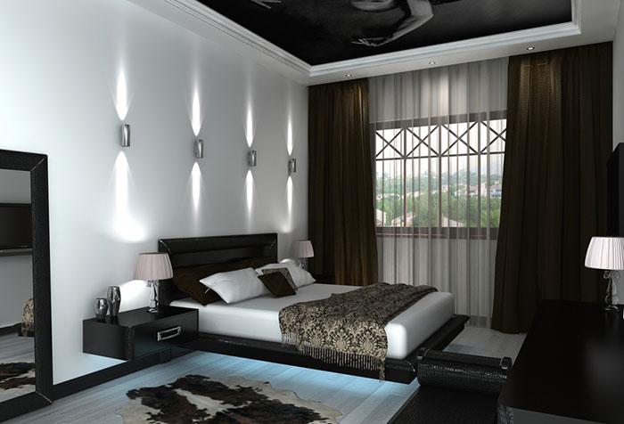 Темные шторы на потолочном карнизе в спальне